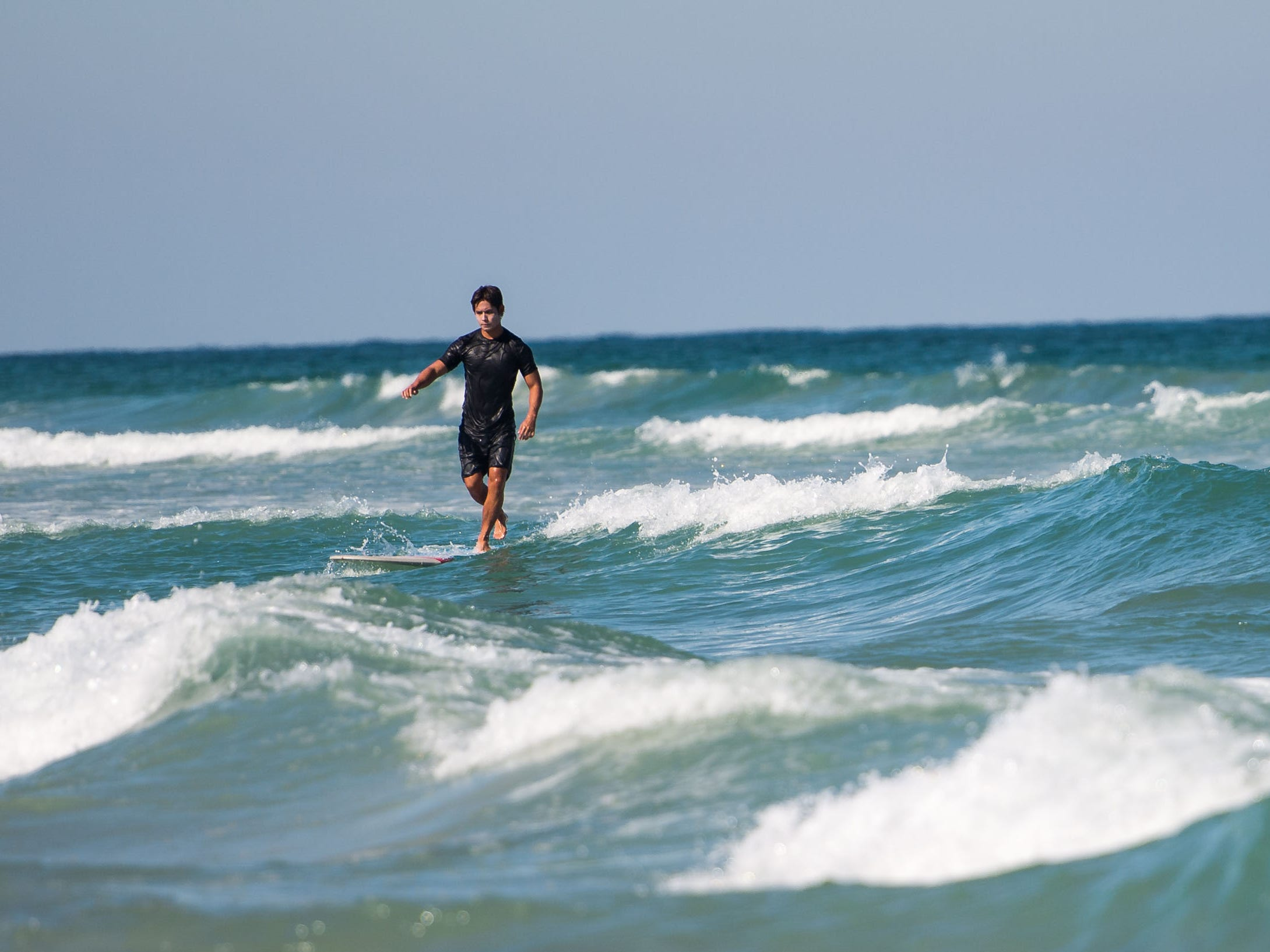 Surfers were out enjoying the waves at Fort Pierce Inlet State Park on Monday, Oct. 29, 2018, while other beaches on North Hutchinson Island were in various stages of being re-opened after a cleanup of dead fish due to red tide in St. Lucie County.