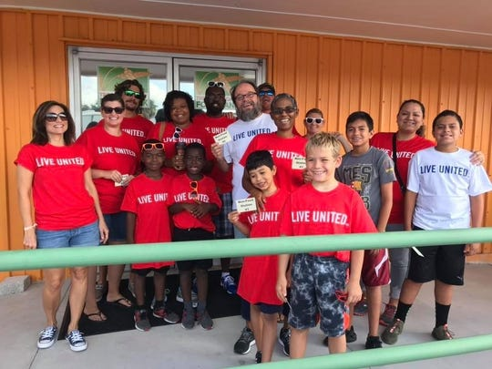 Team CCK volunteers at the Treasure Coast Food Bank during the United Way of St. Lucie County's Day of Caring.
