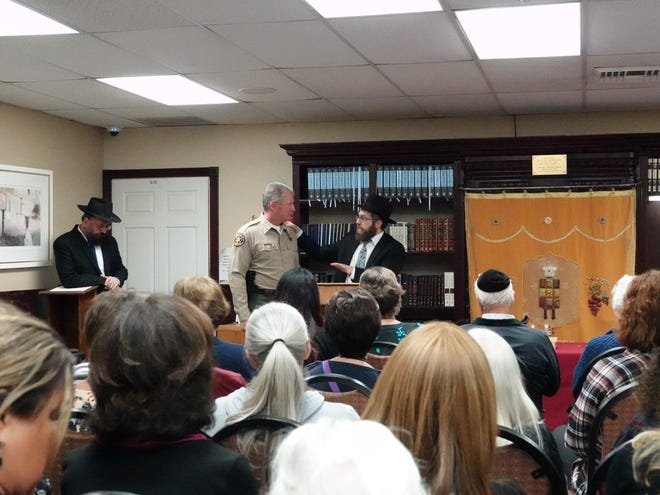 Rabbi Aryeh Lang, right, thanks Ventura County Sheriff Geoff Dean for attending a gathering of the Jewish community at Chabad of Camarillo Sunday night following Saturday's synagogue massacre in Pittsburgh.