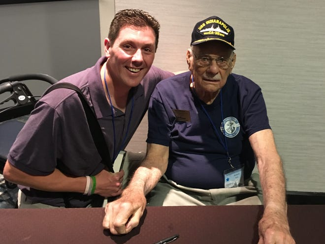 Edgar Elementary School teacher Colin Hanson poses with Richard Thelen, on of 14 USS Indianapolis living survivors. The photo was taken at the USS Indianapolis reunion held in July in Indianapolis.