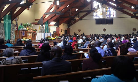 Members of the Haitian community attend Creole Mass at Saint Joseph Church in Spring Valley on Oct. 21, 2018.