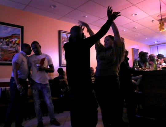 Local Haitians dance to a live Haitian band called DJazz NewYork LA perform Haitian compas music at La Baguette d'Or bistro in Spring Valley on Oct. 20, 2018.