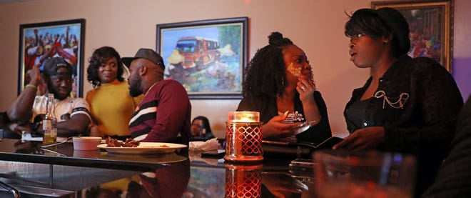 Local Haitians listen to a live Haitian band called DJazz NewYork LA perform at La Baguette d'Or bistro in Spring Valley on Oct. 20, 2018.
