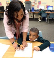 Chantel Laventure-Louis helps her youngest son, Jovanny Louis, with his homework at Pearl River Middle School Oct.17, 2018.