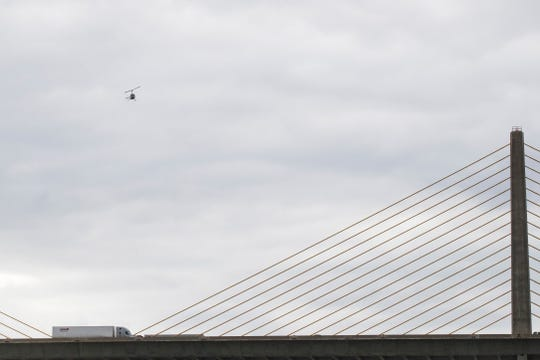 Friends and family search for a 23-year-old woman who jumped from the northbound span of the William V Roth Jr. Bridge Friday afternoon near St. George's.