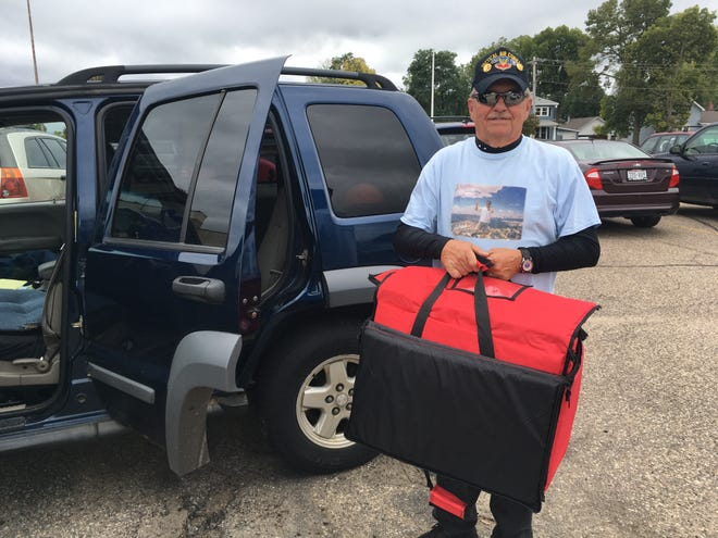 David Arendt displays one of the insulated bags he uses for transporting food before returning it to Edgewater Haven.
