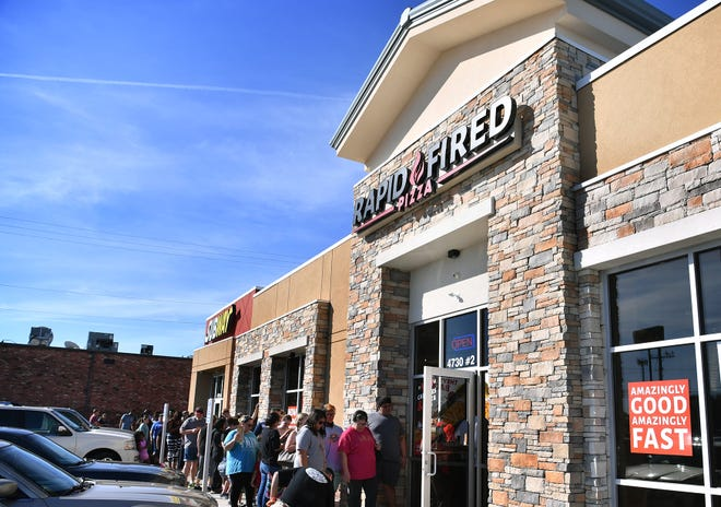 Rapid Fired Pizza opened Monday morning offering the first 500 customers a free pizza. The line went down the sidewalk and out to the street.