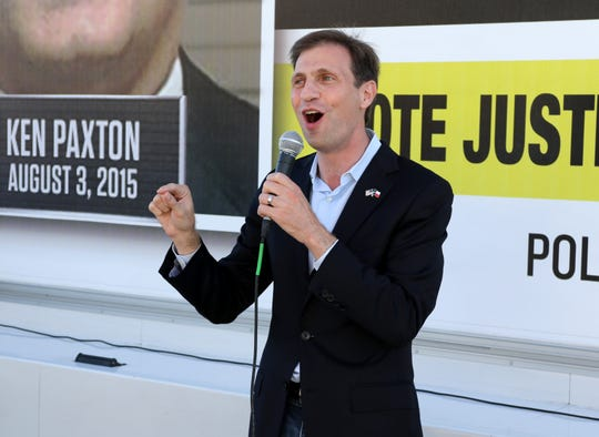 Justin Nelson, Texas attorney general candidate, campaigns Sunday, Oct. 28, 2018, outside the Wichita County Democratic office.