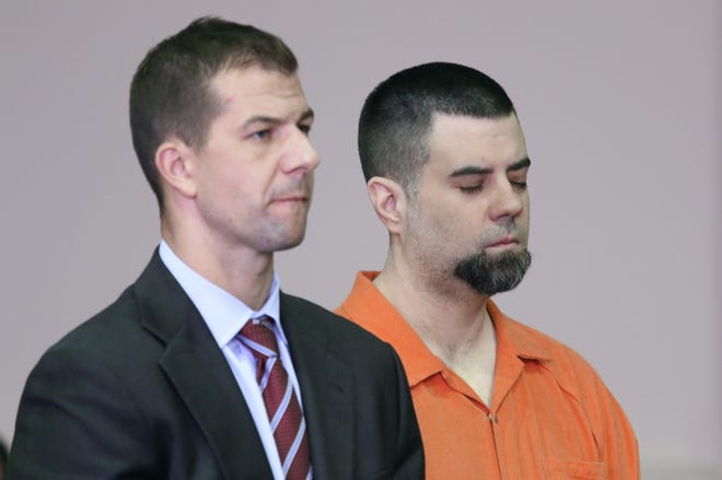 Dirk Hoopes closes his eyes as he is sentenced to prison for torturing a relative.