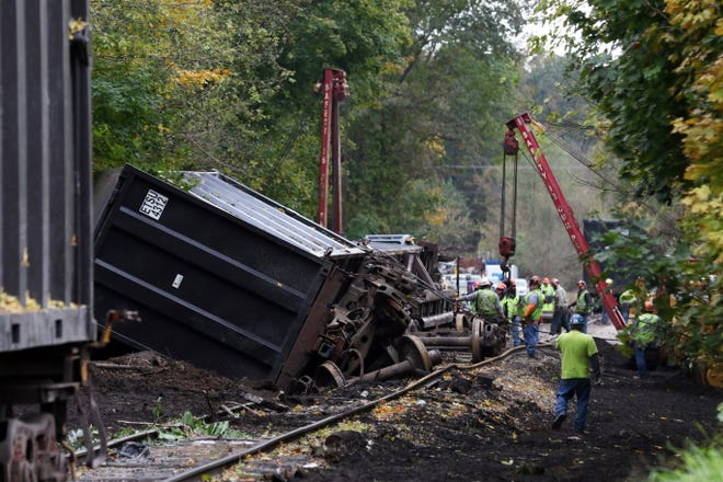 A crew works to cleanup a derailment on the Ohio Central Railroad in Zanesville Monday afternoon. On Saturday, several cars of trash derailed while heading to a landfill in Perry County. No one was injured in the incident.