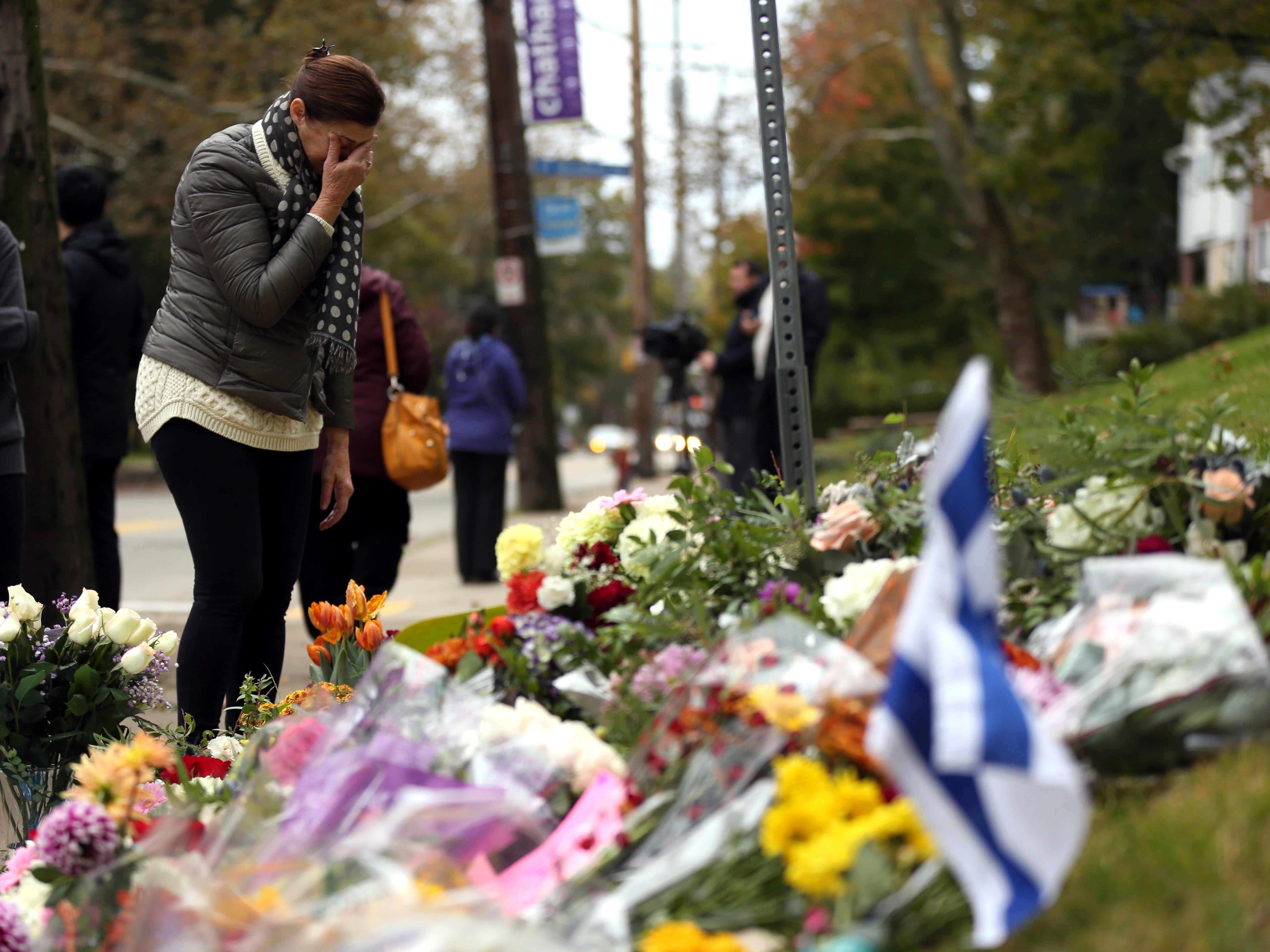A person mourns at a makeshift memorial at the Tree of Life Congregation synagogue in Pittsburgh.