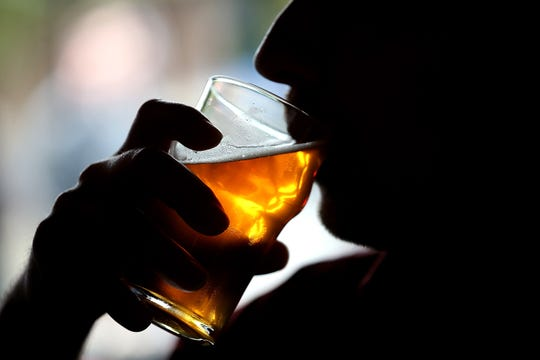A Russian River Brewing Company customer takes a sip of the newly released Pliny the Younger triple IPA beer on February 7, 2014 in Santa Rosa, California.