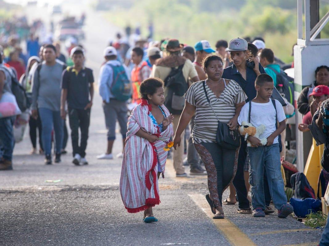 The caravan of migrants pass through Tapanatepec, Oaxaca, Mexico on Monday.