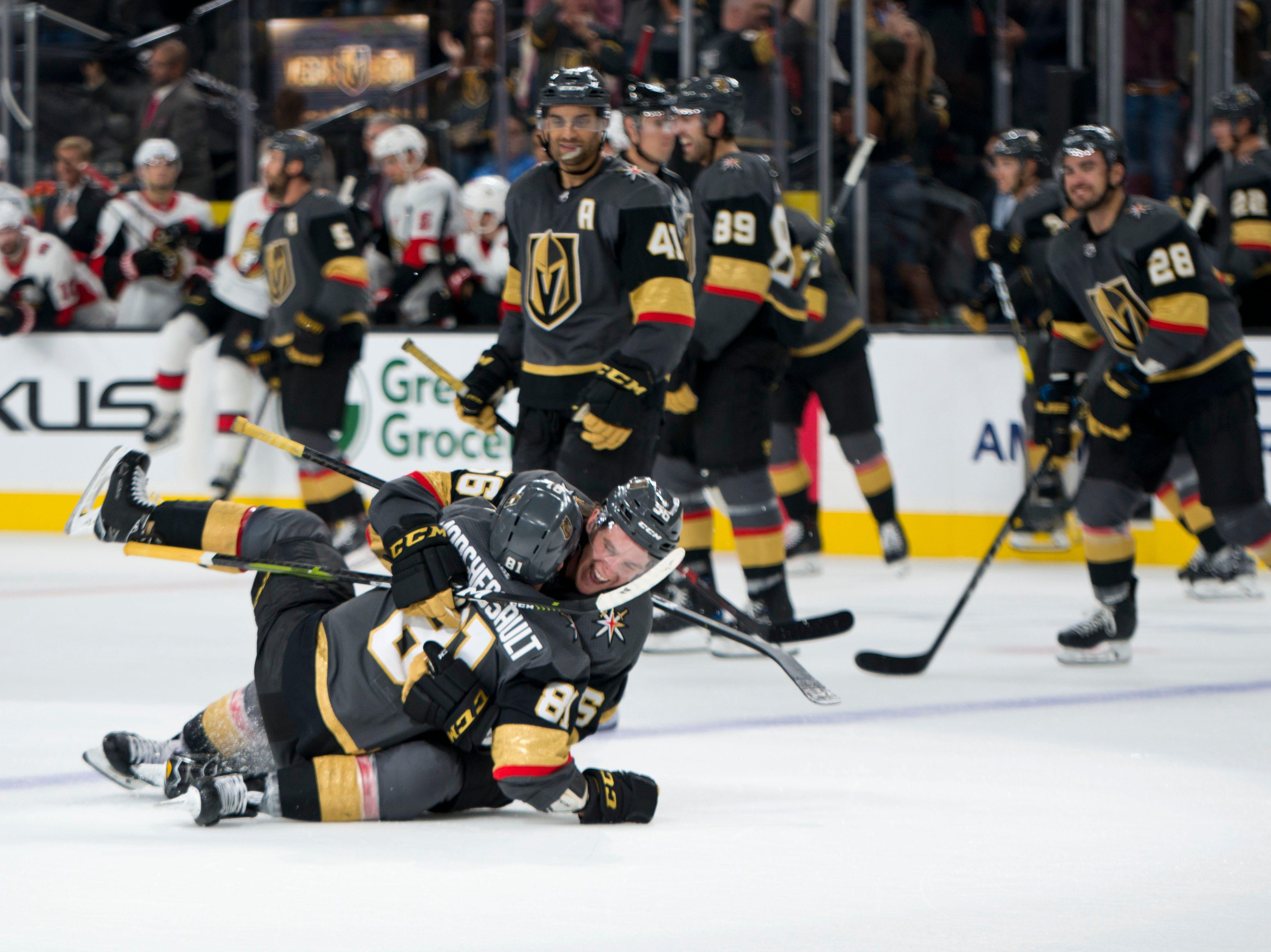 Oct. 28: Vegas Vegas Golden Knights center Jonathan Marchessault (81) celebrates with left wing Erik Haula (56) after scoring the game-winning goal in overtime against the Ottawa Senators.