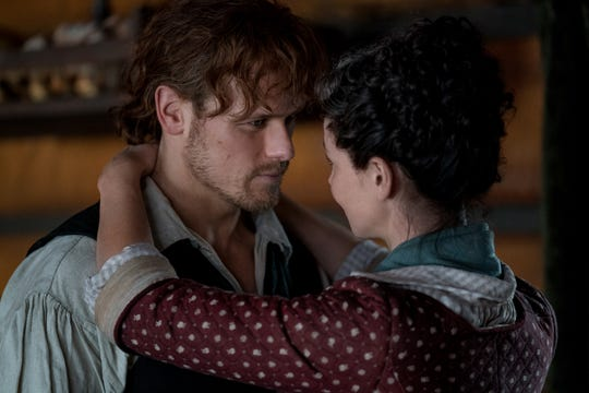 Jamie (Sam Heughan) and Claire (Caitriona Balfe) share a meaningful embrace in Starz's fourth season of 'Outlander.'