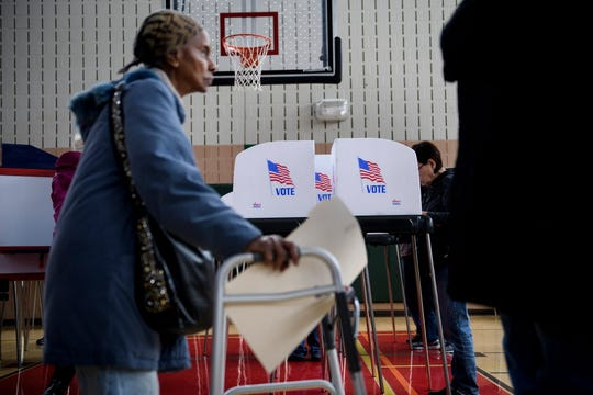 A woman waits in line to cast her ballot during early voting at a community center October 25, 2018 in Potomac, Maryland, two weeks ahead of the key US midterm polls.