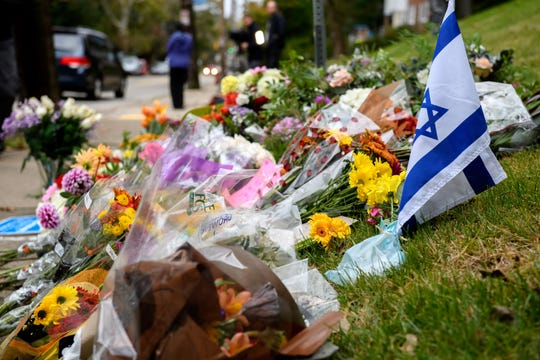 Flowers and cards sit at a makeshift memorial down the street from the site of the mass shooting that killed 11 people and wounded 6 at the Tree of Life Congregation synagogue in Pittsburgh.