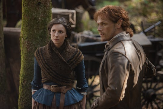 Claire (Caitriona Balfe) and Jamie (Sam Heughan) face the Cherokee tribe as Starz's 'Outlander' ventures to 18th-century America in Season 4.