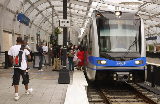 File picture - passengers catch a ride on the LYNX light rail subway system on July 11, 2012 in Charlotte, North Carolina.