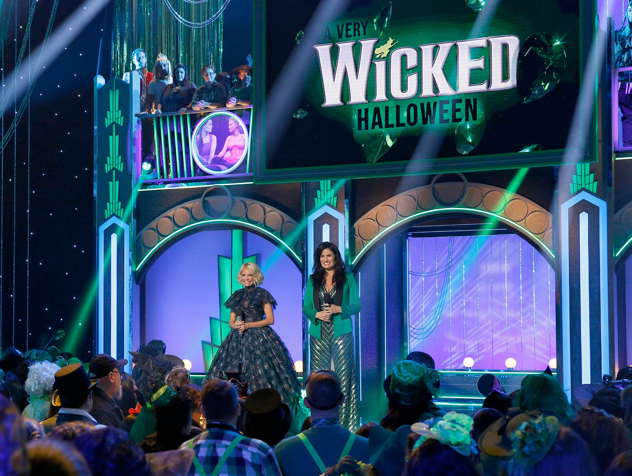 "This image released by NBC shows Kristin Chenoweth, left, and Idina Menzel from the Halloween-themed TV special ""A Very Wicked Halloween: Celebrating 15 Years On Broadway,"" airing on NBC on Oct. 29 at 10pm ET. Chenoweth and Menzel were original stars of the Broadway production. (Eric Liebowitz/NBC via AP) ORG XMIT: NYET213"