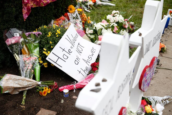 Flowers, candles, and letters are left at the Star of David memorials with the names of the 11 people who were killed at the Tree of Life synagogue two days after a mass shooting in Pittsburgh, Pennsylvania.