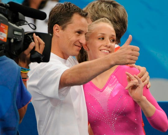 In a file photo from the 2008 Olympics, Valeri Liukin gives the thumbs up after his daughter Nastia Liukin wins the gold medal in the women's all-around final in Beijing.