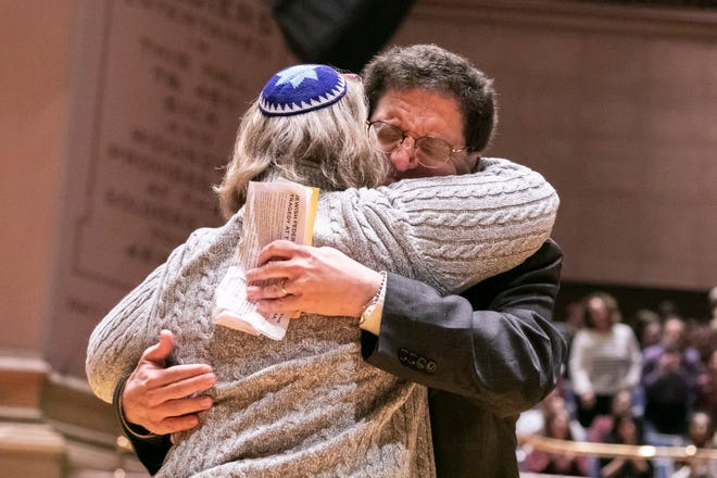 Community members gather at the Soldiers & Sailors Memorial Hall for a vigil for the victims of the mass shooting at the Tree of Life Congregation synagogue in Pittsburgh.