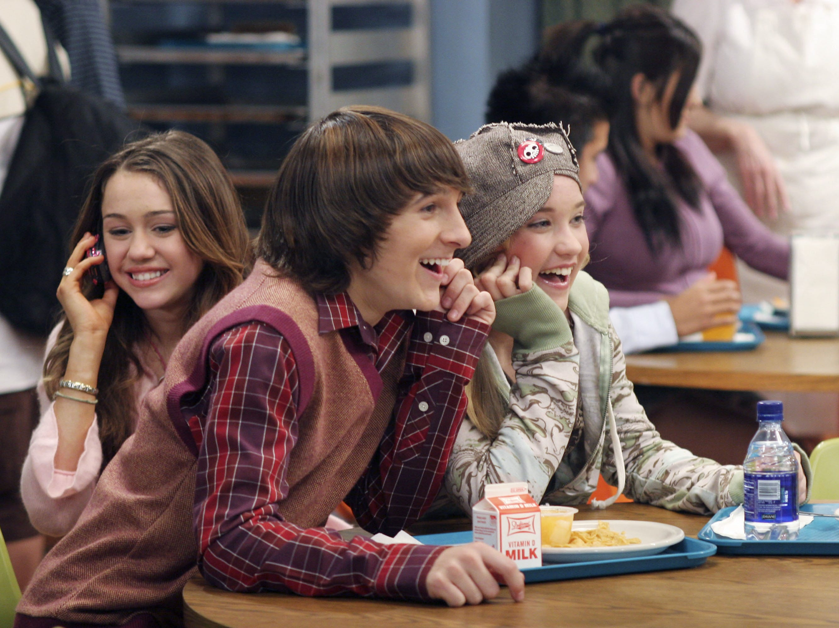 "Left to right: Miley Cyrus, Mitchel Musso, Emily Osment in a scene from the episode of the television program ""Hannah Montana"" entitled ""Idol Side of Me."" Photo by Danny Feld, Disney Channel  (Via MerlinFTP Drop)"