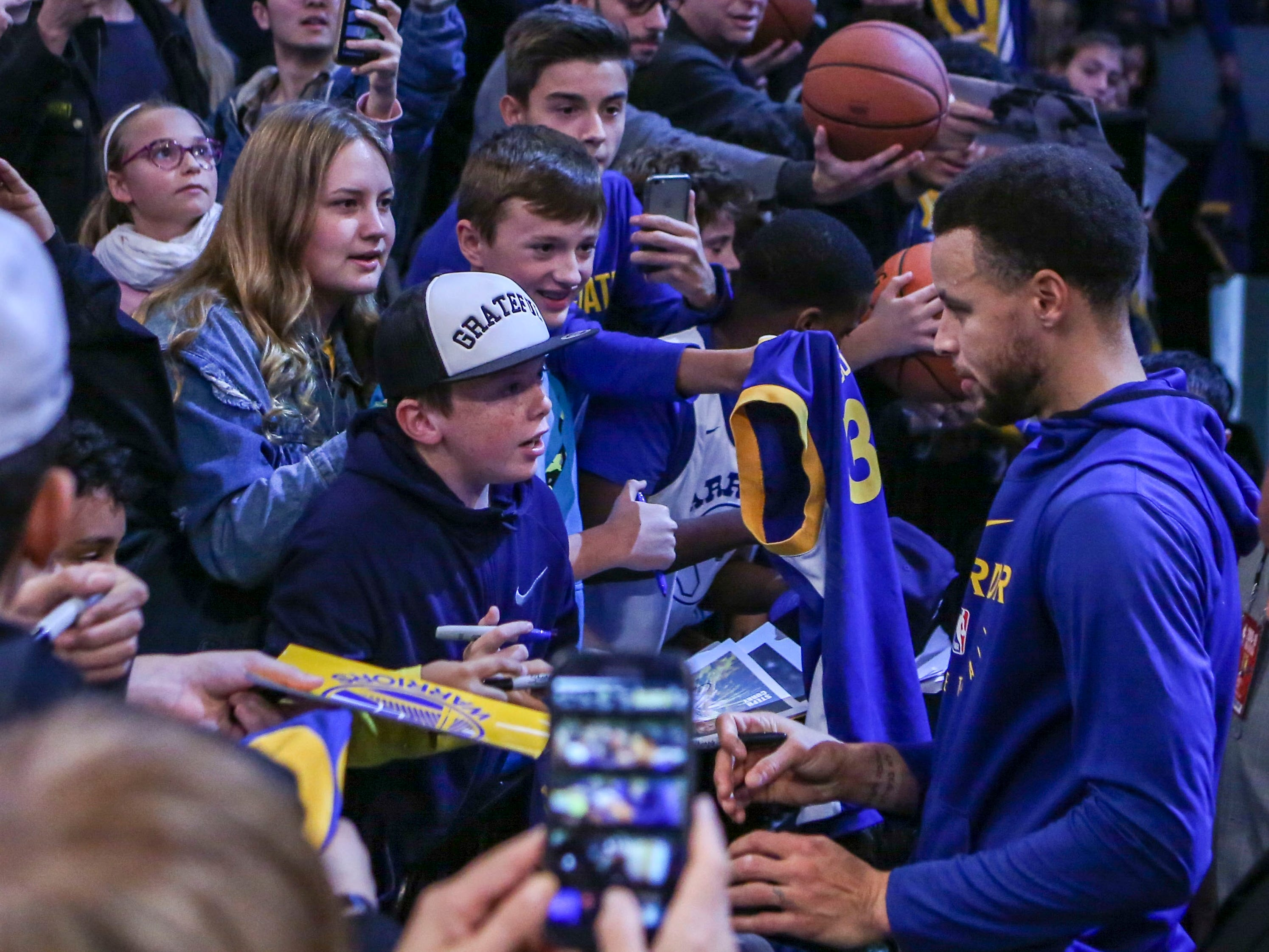 Oct. 28: Always a fan favorite, Warriors star Steph Curry signs autographs before playing the Nets in Brooklyn.