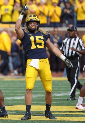 Michigan defensive lineman Chase Winovich celebrates an interception against Nebraska quarterback Adrian Martinez at Michigan Stadium.