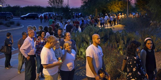 Long lines at fewer polling places plagued the 2016 vote across the Phoenix region. People wait in line to vote in the primary at the Environmental Education Center on March 22, 2016, in Chandler, Arizona.