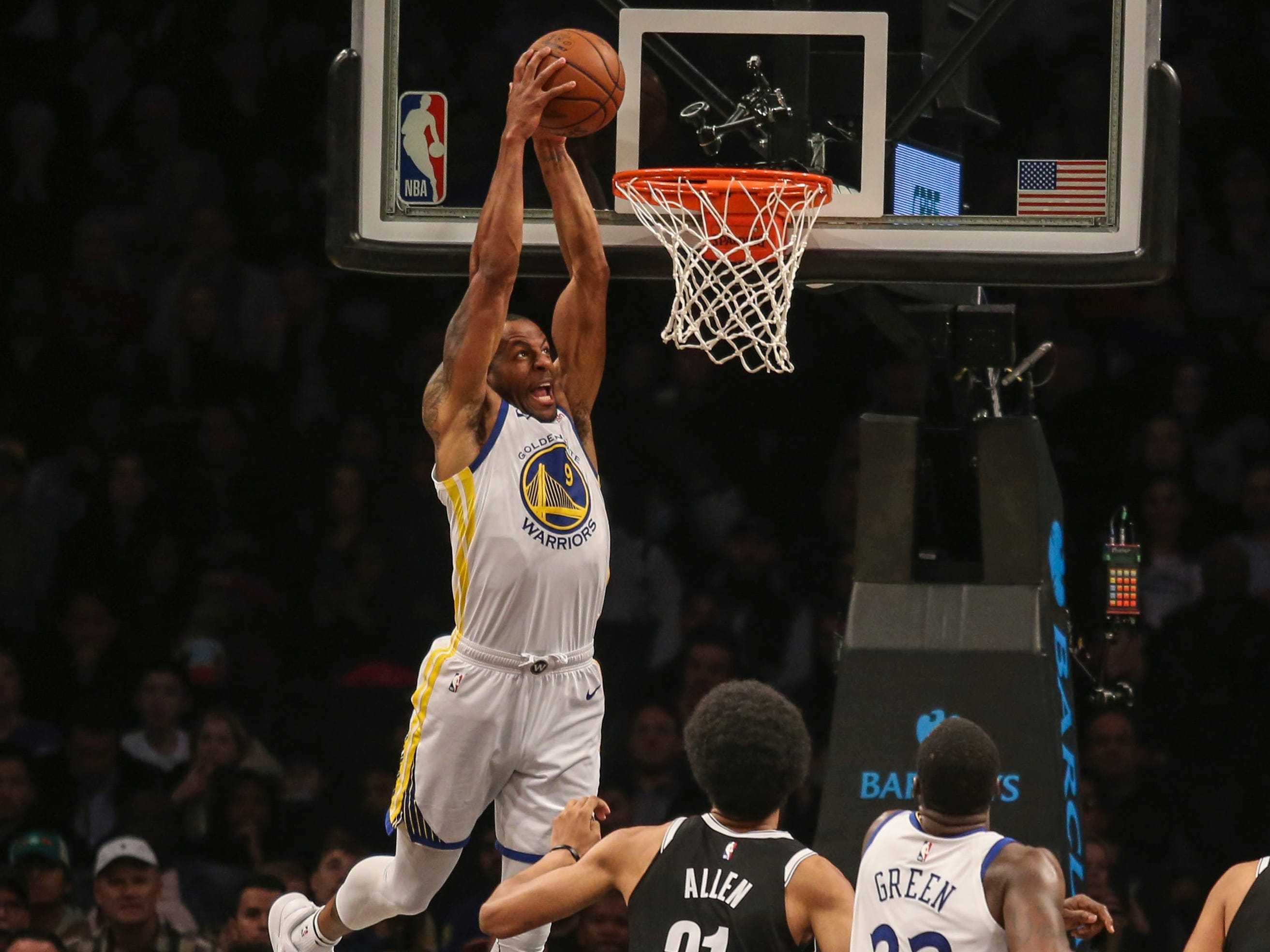 Oct. 28: Warriors forward Andre Iguodala throws down a two-handed slam against the Nets in Brooklyn.