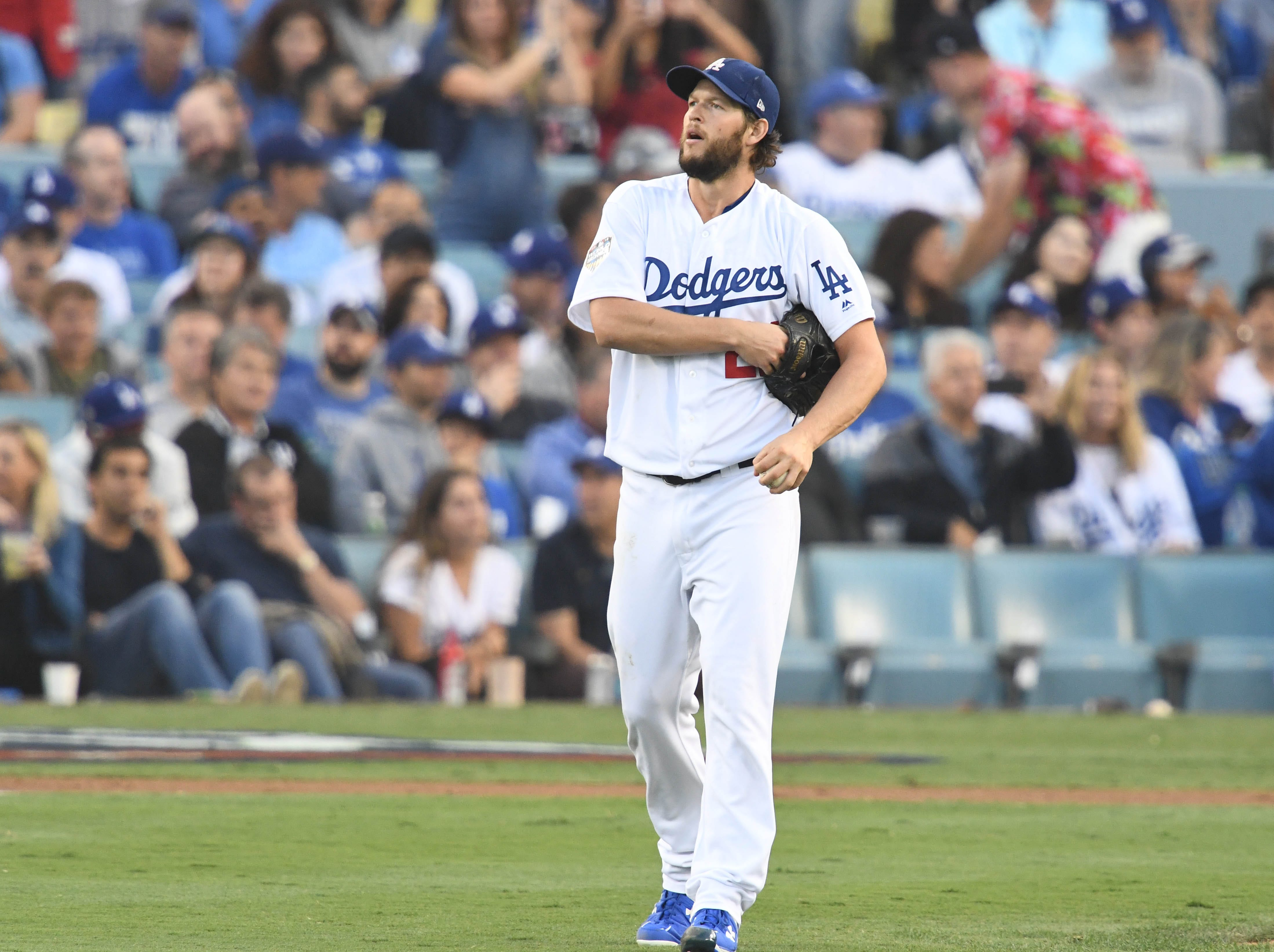 Game 5 at Dodger Stadium: Clayton Kershaw reacts after Steve Pearce's two-run homer in the first.