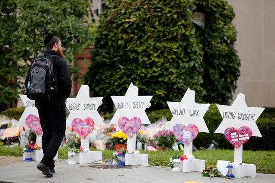 A man visits a memorial outside of the Tree of Life Congregation Synagogue in the Squirrel Hill neighborhood of Pittsburgh on Oct. 29, 2018.