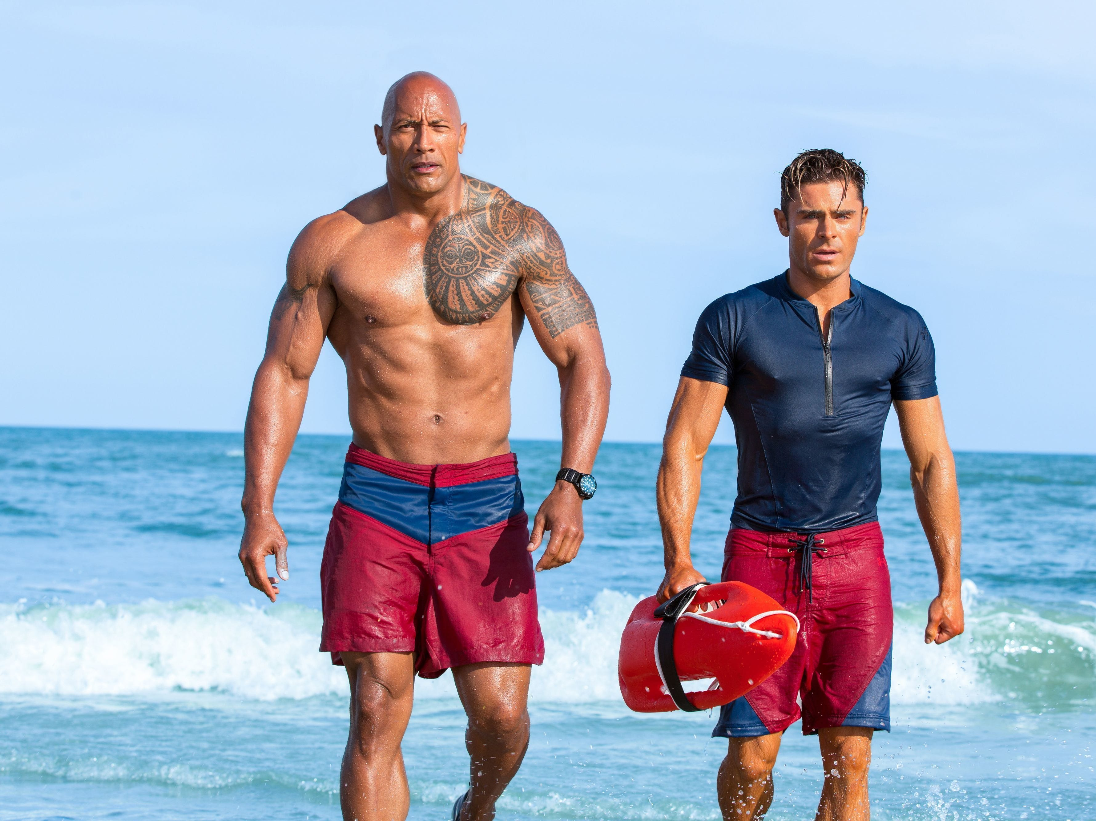 "Dwayne Johnson (left) and Zac Efron hit the beach for ""Baywatch."""