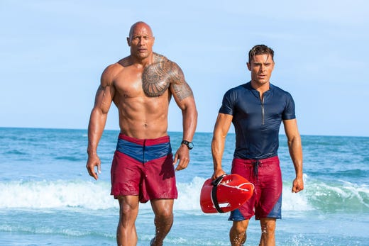 """Efron has been busy since his days playing a singing basketball player, co-starring in Baywatch with Dwayne Johnson (left), """"Mike and Dave Need Wedding Dates,"""" and """"The Greatest Showman"""" (playing the romantic interest opposite a more recent Disney Channel alum, Zendaya). Most recently, he hosted his own Netflix travel show, titled """"Down to Earth with Zac Efron."""""""