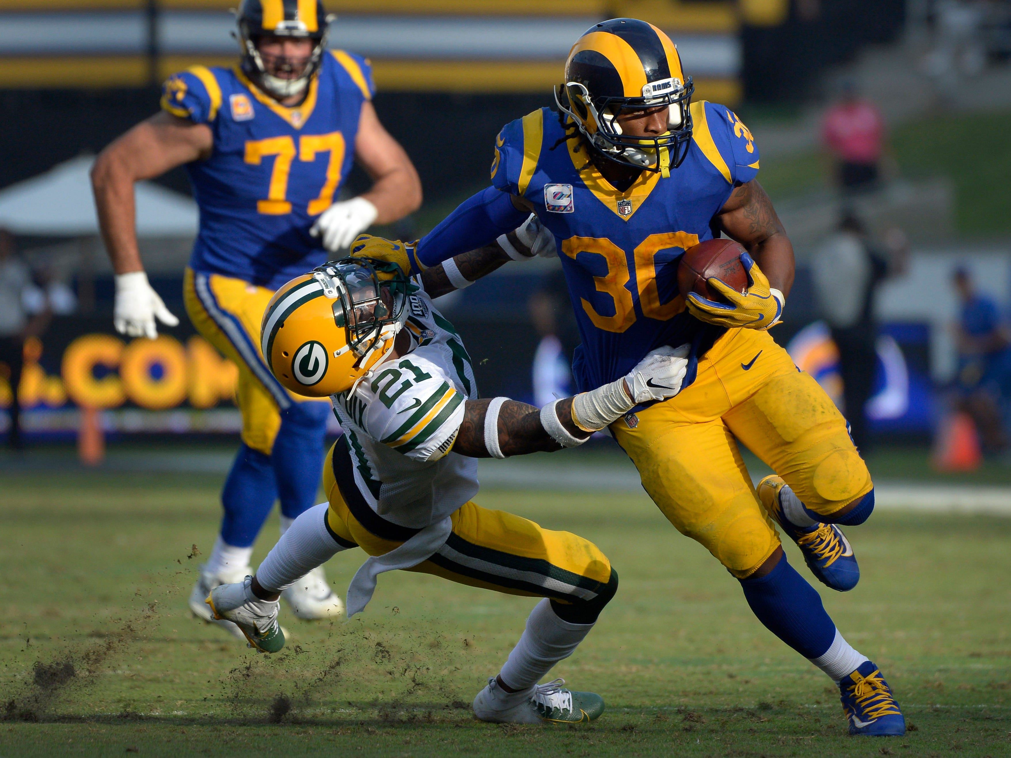 Week 8: Los Angeles Rams running back Todd Gurley stiff arms Green Bay Packers free safety Ha Ha Clinton-Dix on a fourth quarter run at Los Angeles Memorial Coliseum. The Rams won the game, 29-27.