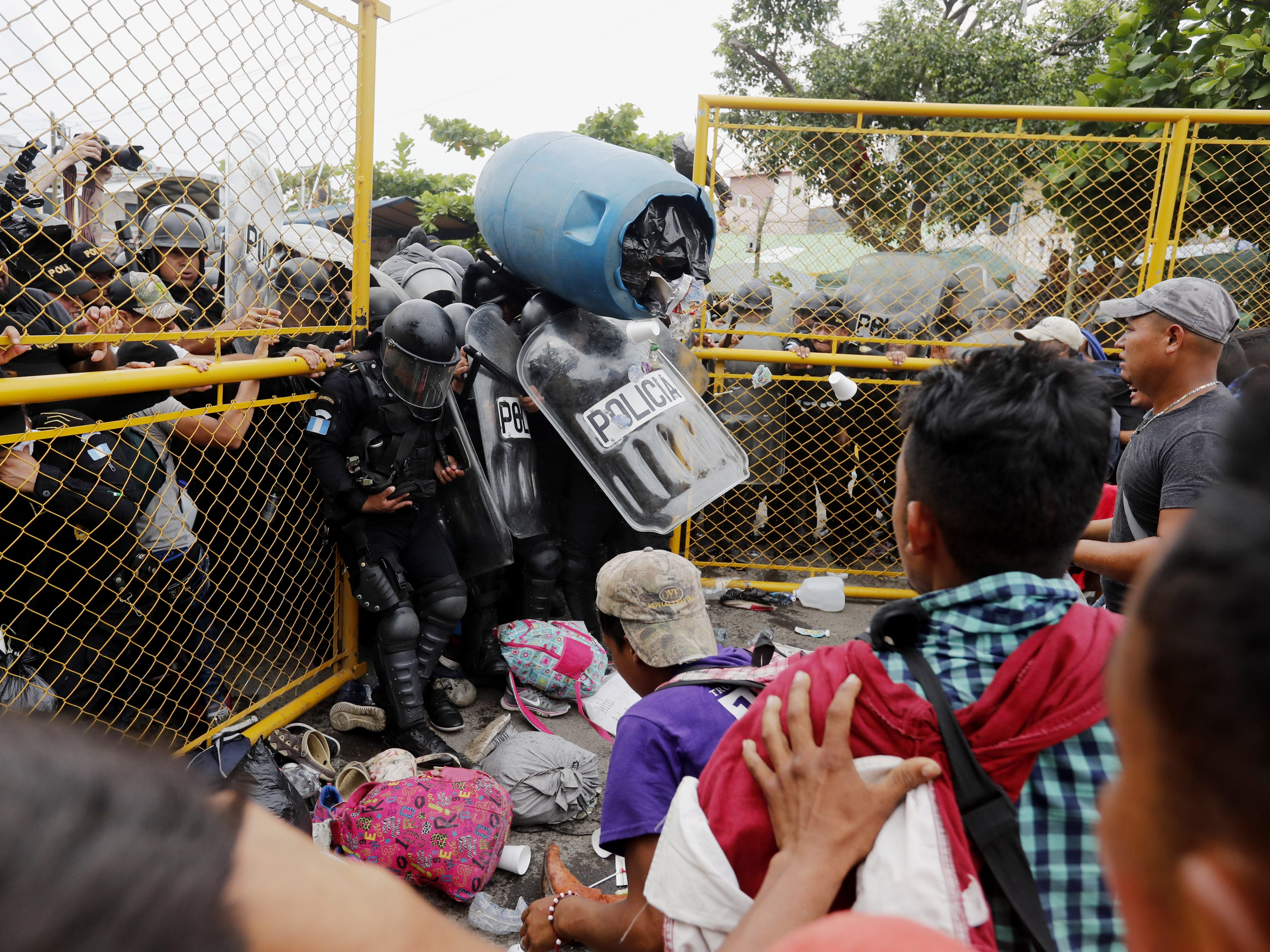 Migrants of the second caravan clash with the Guatemalan Police, in Tecun Uman, Guatemala on Oct. 28, 2018. Thousands of migrants broke the border fence between Guatemala and Mexico and crossed into the Mexican territory.