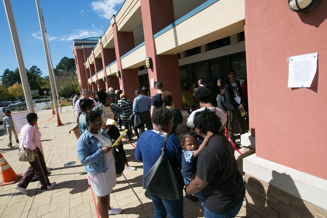 MARIETTA, GA - OCTOBER 18: Voters wait in line for up to two hours to early vote at the Cobb County West Park Government Center on October 18, 2018 in Marietta, Georgia. Early voting started in Georgia on October 15th.