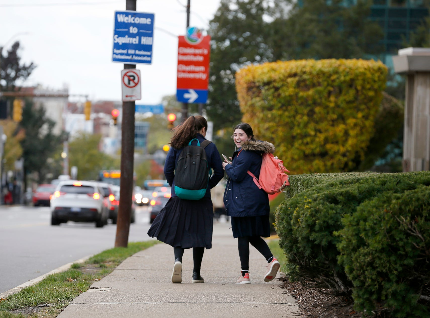 Students of Yeshiva Girls High School walk along Forbes Avenue in the Squirrel Hill neighborhood of Pittsburgh, Pa., near Tree of Life Congregation Synagogue.