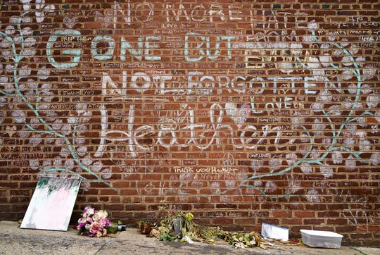 Flowers and gifts sit under the memorial wall for Heather Heyer in Charlottesville, Virginia, just off the honorary Heather Heyer Way. The city renamed a stretch of Fourth Street for Heyer, 32, who was killed by a motorist.