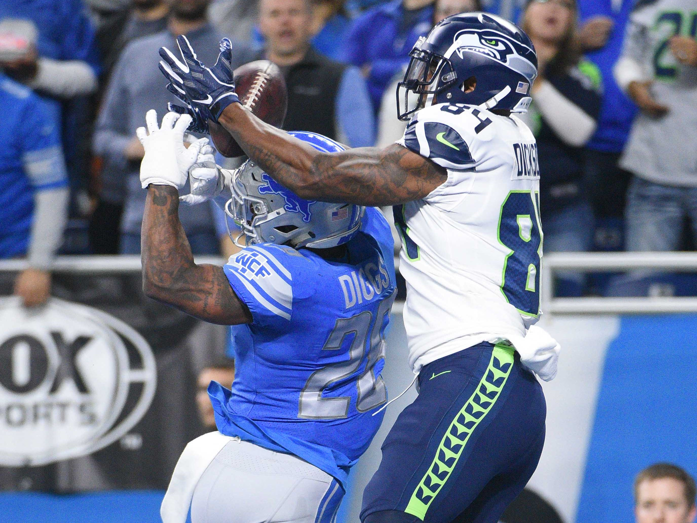 Week 8: Seattle Seahawks tight end Ed Dickson scores a touchdown as Detroit Lions cornerback Nevin Lawson defends during the second quarter at Ford Field. The Seahawks won the game, 28-14.