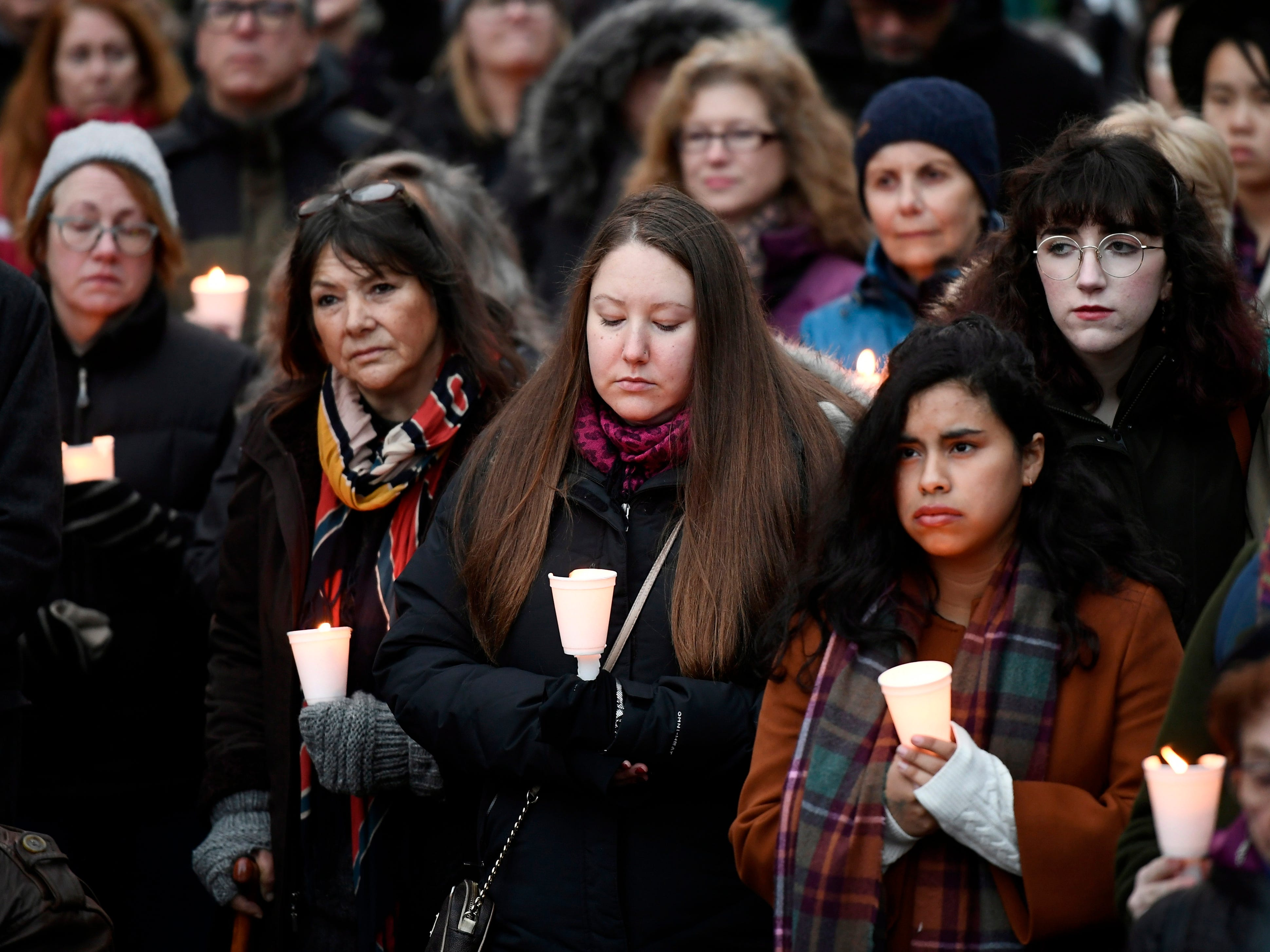 People hold candles during a vigil against anti-Semitism and white supremacy, in response to the shooting at the Tree of Life Congregation synagogue in Pittsburgh, at the Human Rights Monument in Ottawa, Ontario, on Oct. 28, 2018.