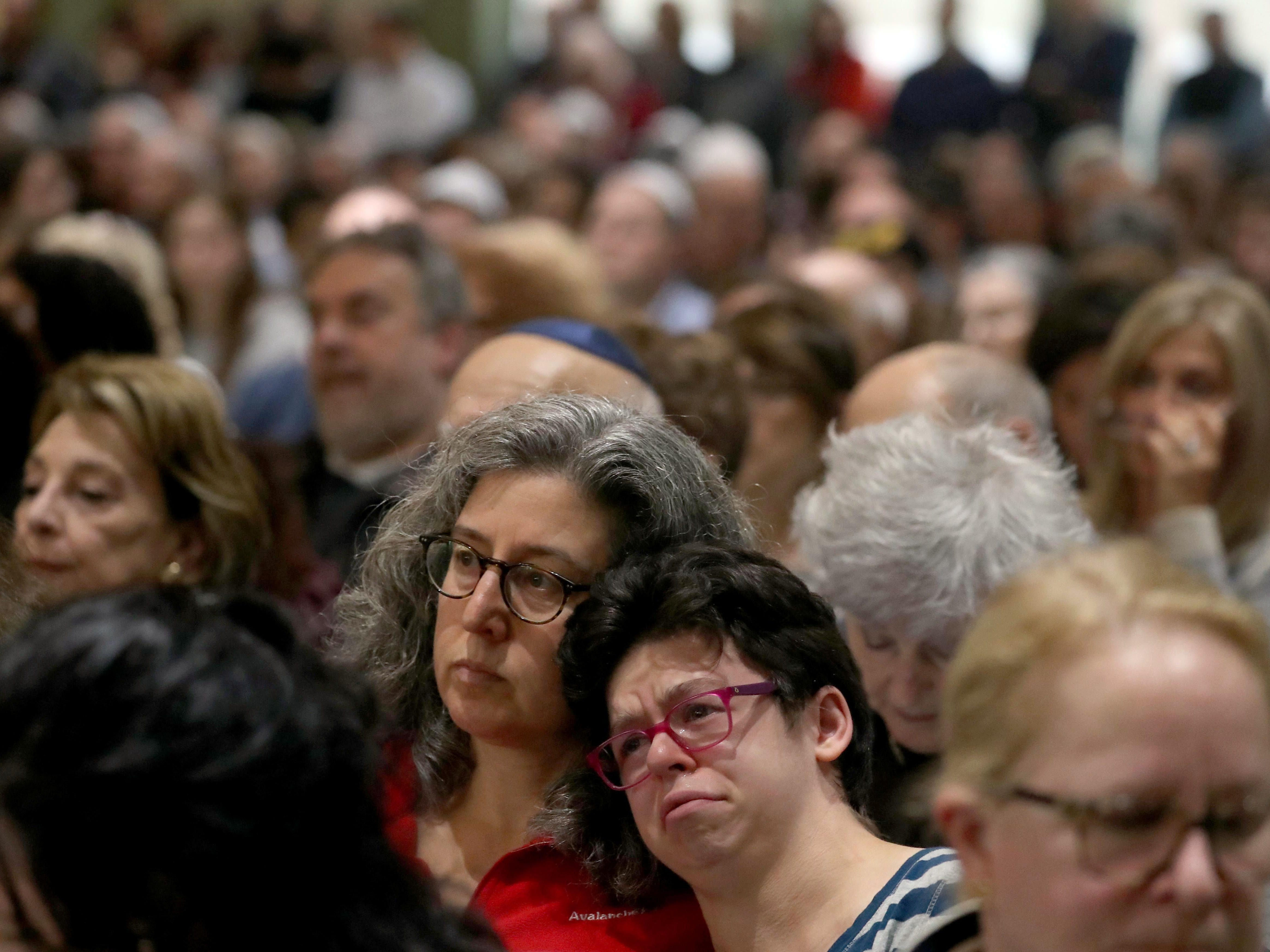 Hundreds of area residents filled the seats and stood during a vigil at Congregation Kol Ami in White Plains, N.Y. on Oct. 28, 2018, in response to the mass shooting at the Tree of Life Congregation synagogue in Pittsburgh synagogue. The vigil was organized by several Westchester County based Jewish organizations.