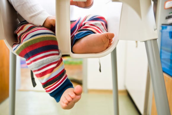 New federal safety standards for high chairs will require a passive crotch restraint (two separate bounded openings for the occupant's legs) starting in 2019.