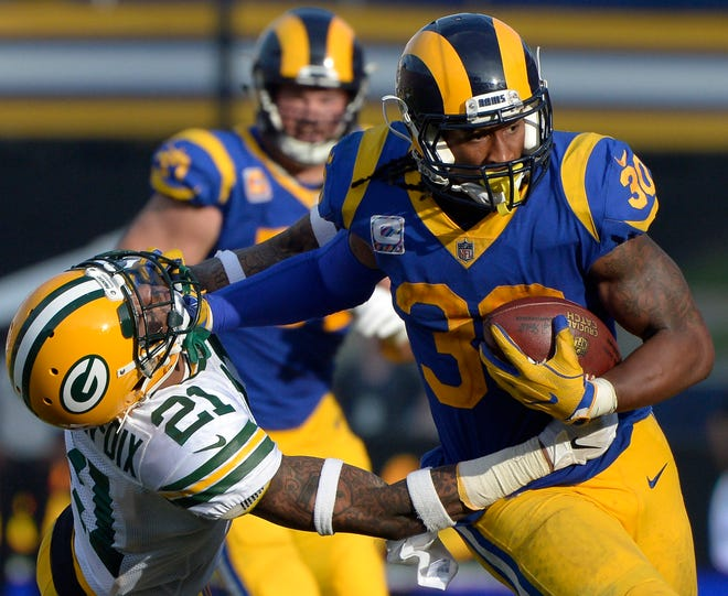 Todd Gurley stiff arms Green Bay Packers free safety Ha Ha Clinton-Dix.