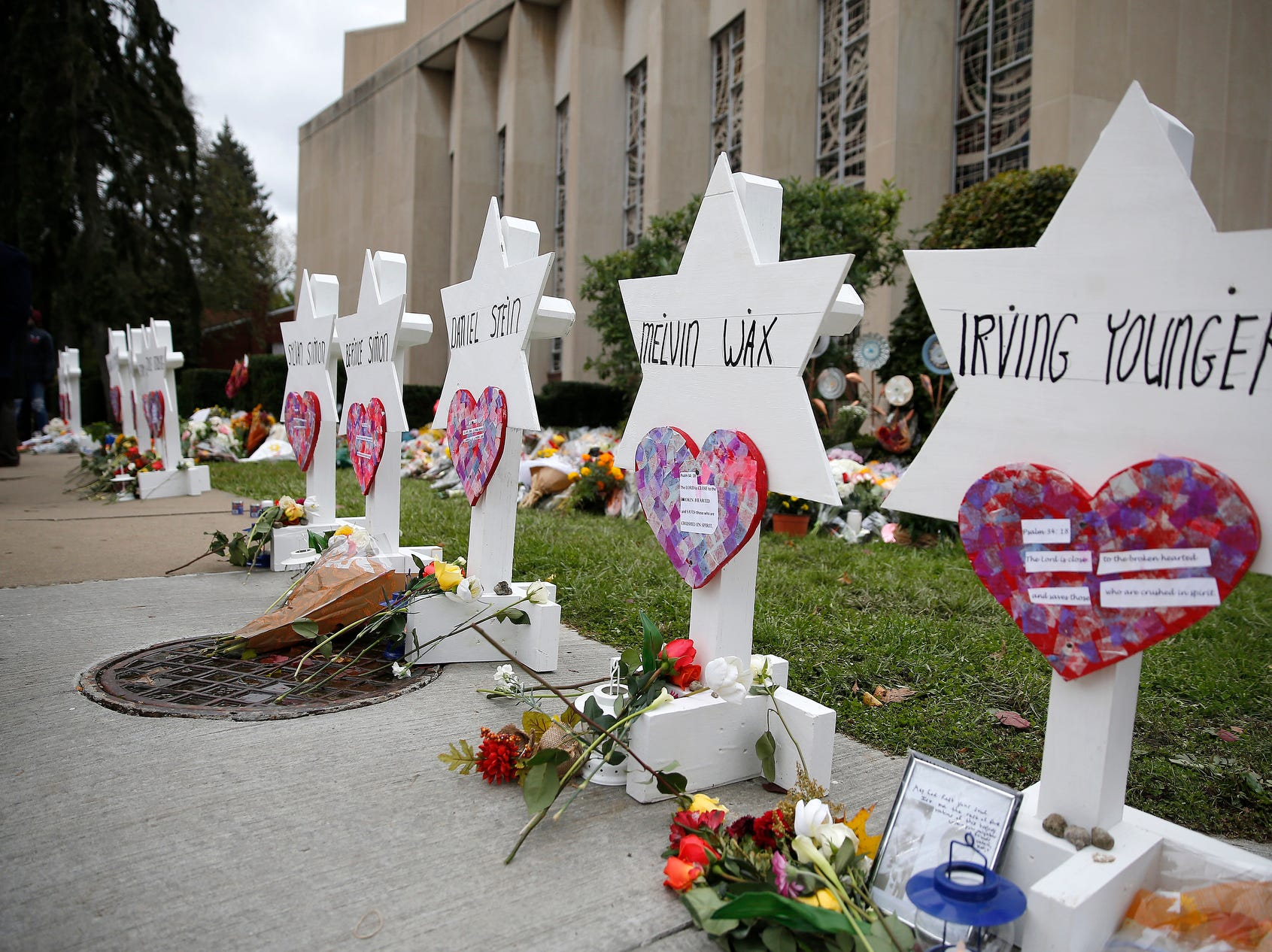 Names of the victims in the mass shooting at Tree of Life Congregation Synagogueare posted at a memorial outside of the synagogue in the Squirrel Hill neighborhood of Pittsburgh, Pa.,  Monday.