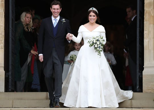 Princess Eugenie of York and her husband Jack Brooksbank emerge from St George's Chapel at Windsor Castle after their wedding on Oct. 12, 2018.