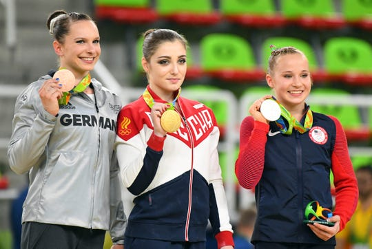 At the 2016 Olympics,  Aliya Mustafina of Russia celebrated her gold alongside Sophie Scheder of Germany and Madison Kocian of the USA.