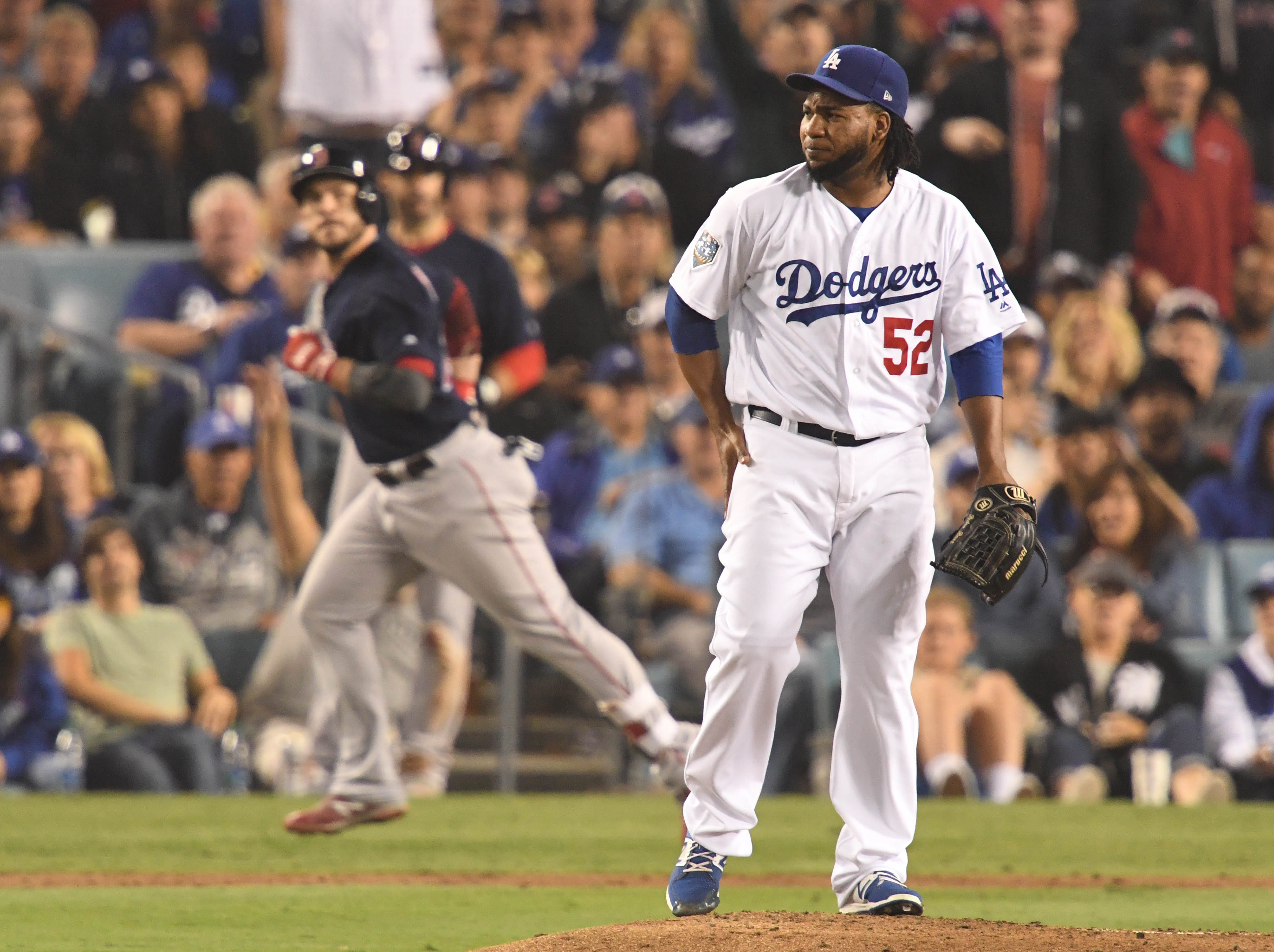 Game 5 at Dodger Stadium: Pedro Baez gives up a solo home run to Steve Pearce in the eighth inning.